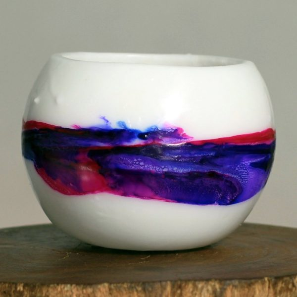 Rich hues of pink, violet and marine blue create a beautiful, misty, morning vista. Photo: Integrity Candles collection.