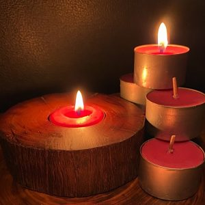 Each scented tea-light cup burns brightly for eight hours.
