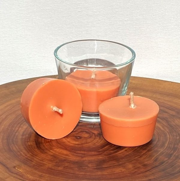 Three Sweet Orange, Ginger, Cinnamon & Vanilla pure soy Votives, with one glass, burn brightly for a total of 24 hours with a warm, spicy aroma.