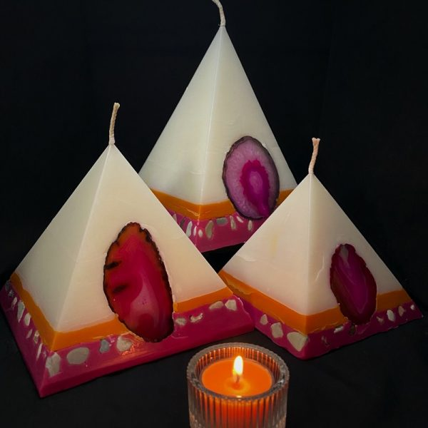 Our Frangipani and Ylang Ylang nest of pyramids combined burn time is over 440 hours. As your pyramid candle burns, the flame illuminates the Agate, revealing the stone's unique variegated patterns, and leaves you with a gorgeous keepsake. Frangipani and Ylang Ylang combine in a sweet, light hearted and happy fragrance. In colours of pink and orange, this range will make you want to get your 'go-go' boots on!