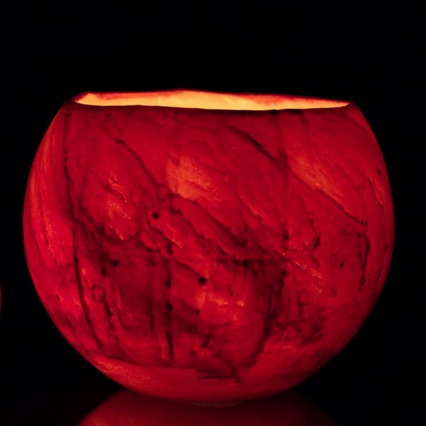 The dramatic glow of the strong red with black accents of the Mars lantern echo the drama of the red planet itself. Photo - Integrity Candles collection