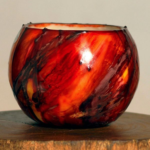 The drama of the Red Planet is reflected in our Mars lantern - dynamic red with black highlights. It is a bold ornament by day, and a dramatic center-point when lit. Photo: Integrity Candles collection.