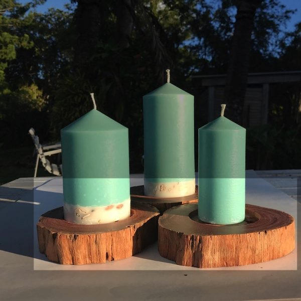 Ironbark plinths showcase Patchouli & Sandalwood pillar candles.