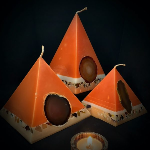 Our Sweet Orange, Ginger, Cinnamon and Vanilla nest of pyramids combined burn time is over 440 hours. As your pyramid candle burns, the flame illuminates the Agate, revealing the stone's unique variegated patterns, and leaves you with a gorgeous keepsake. These candles further feature a variegated coloured base embedded with agate crystal, semi precious stone and river pebbles.