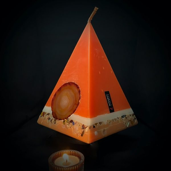 Cleopatra: largest in our Sweet Orange, Ginger, Cinnamon and Vanilla pyramid range burning over 190hrs. As your pyramid candle burns, the flame illuminates the Agate, revealing the stone's unique variegated patterns, and leaves you with a gorgeous keepsake. This candle further features a variegated coloured base embedded with agate crystal, semi precious stone and river pebbles. Visually bold and beautiful rich in tones of apricot with a warmly spiced scent, these candles illuminate brightly and boast an exceptionally long burn time.