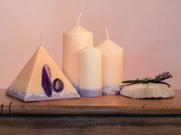 Our Lavender and Vanilla candle nest includes one 90 hour pyramid and three pillar candles (40 hour, 90 hour and 140 hour) a combined burn time over 360 hours. As your pyramid burns, the flame illuminates the Agate crystal, revealing the stone's unique variegated patterns and leaving you with a gorgeous keepsake. The base of all candles are embedded with river pebbles. Deeply relaxing, this intoxicating combination of essential oils make this light cream coloured candle a favourite. The lilac base, is now separated by a warm autumn tone of colour.