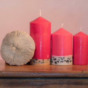 Exotic and mystical, Dragon's Blood has been used across the ages in magic, medicine, art, and as a heady, intoxicating fragrance. The alluring red candle features a white base embedded with small black stone.