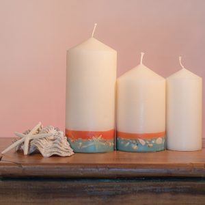 This tropically scented candle range is infused with essential oils of Lime and Coconut. White in colour, these candles feature an orange and blue banded base embedded with sea shells.