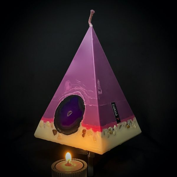 Cleopatra: largest in our pyramid range burning over 190 hours. Deeply relaxing, essential oils of Lavender, Patchouli, Citrus, Marjoram, Jojoba, Geranium and Chamomile are presented in a meditative shade of purple. A band of magenta sits above a white base embedded with agate slices and river pebble. As your pyramid candles burn, the flame illuminates the Agate, revealing the stone's unique variegated patterns, and leaves you with gorgeous keepsakes.