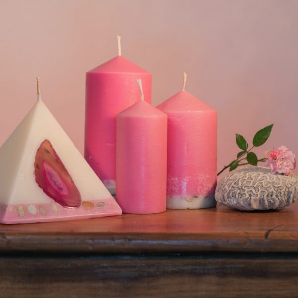 Our Rose and Geranium candle nest includes one 90 hour pyramid and three pillar candles (40 hour, 90 hour and 140 hour) a combined burn time over 360 hours. As your pyramid burns, the flame illuminates the Agate crystal, revealing the stone's unique variegated patterns and leaving you with a gorgeous keepsake. The base of the pillar candles are embedded with river pebbles. Essential oils of Rose and Geranium oils create a luxurious scent with fresh and relaxing overtones.