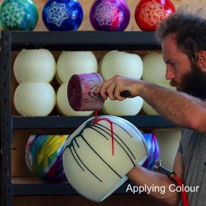Applying pigments to the lantern prior to blending the colours by torch. Photo: Integrity Candles