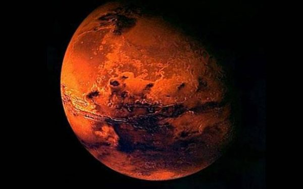 Mars is the fourth planet from the Sun and is the second smallest in the solar system. It is named after the Roman god of war. The Mars symbol (♂) is a depiction of a circle with an arrow emerging from it, pointing at an angle to the upper right. It is also the old and obsolete symbol for iron in alchemy. In biology and botany, it is used to represent the male sex (alongside the astrological symbol for Venus representing the female sex), following a convention introduced by Linnaeus in the 1750s. Photo: NASA via Wikipedia