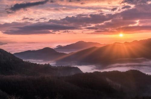 The dramatic beauty of morning sunrise. Photo by Tadej Skofic - Unsplash